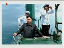 Kim Jong-un directing on the conning tower of a submarine