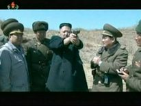 Still image from video shows North Korea's leader Kim Jong-un holding up a pistol as he supervises pistol and automatic file firing drills at the second battalion under North Korea People's Army