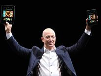 Amazon chief executive Jeff Bezos with the new device