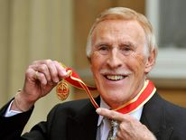 Sir Bruce Forsyth Knighted At Buckingham Palace