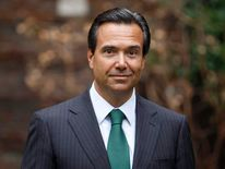 Lloyds Banking Group CEO Antonio Horta Osorio poses outside the bank's headquarters on his first day back at work after taking a leave of absence due to exhaustion, in the City of London