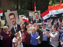 Women shout slogans during a sit-in to protest against potential U.S. strikes on Syria in Damascus