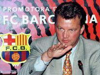 FC Barcelona's new Dutch coach Louis Van Gaal gestures at a press conference after signing a three-y..