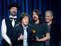 Musicians Krist Novoselic, Paul McCartney, Dave Grohl, and Pat Smear