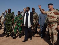 Malian President Traore visits French soldiers at an air base in Bamako