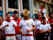 A man wears a horse's head mask at the San Fermin festival