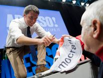 Democratic Party member and Mayor of Florence Matteo Renzi signs autographs as he rallies onstage in Turin