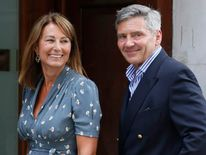 Michael and Carole Middleton arrive at the Lindo Wing of St Mary's Hospital the day after their daughter, Britain's Catherine, Duchess of Cambridge, gave birth to a baby boy, in London
