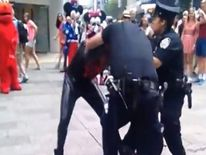 A man dressed as Spider-Man is arrested by police after allegedly punching a police officer. Pic: New York Post.