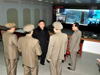 North Korean leader Kim Jong-Un talks with officials at the General Satellite Control and Command Center, in this picture released by the North's KCNA news agency in Pyongyang