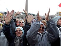 Nuns wave at Pope Benedict XVI during the Angelus in Saint Peter's Square at the Vatican