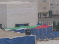 Yassar Arafat's tomb in Ramallah covered by tarpulin during the exhumation of his body