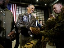 Obama shakes hands with troops after delivering remarks at Bagram Air Base in Kabul