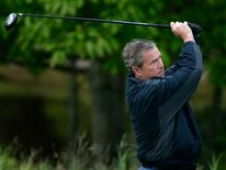 US President George W Bush tees off in Kennebunkport, Maine, in June 2003