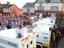 Orangemen protesters clash with police on the return from a march in north Belfast.