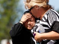 Parents and students are reunited after a shooting at Reynolds High School in Troutdale, Oregon
