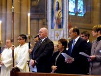 Australian PM Abbott stands with wife Margaret, Governor-General Cosgrove during a service in Sydney