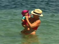 Australia: Mother and baby in sea in heat