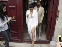 Kinm Kardashian and Kanye West in Paris ahead of their wedding