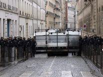 Police block a road in Paris