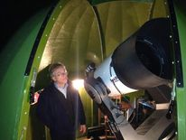 Peter Birtwhistle with the telescope he used to spot the asteroid.