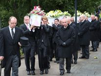 Philpott funeral: coffins are carried into church
