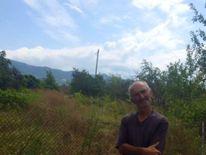 Amiran Gugutishvili, whose orchard has been fenced off