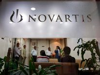 People gather at Novartis India headquarters in Mumbai