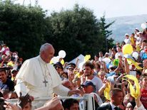 Pope Francis waves as he arrives to lead a prayer in Isernia