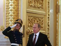President Putin entering a hall in the Grand Kremlin Palace in Moscow