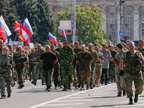 Pro-Russian separatists parade Ukrainian prisoners through Donetsk