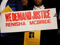 Demonstrators protest against the killing of 19-year-old Renisha McBride outside the Dearborn Heights Police Station
