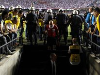 Referee enters locker room to talk to Tigre players during Copa Sudamericana soccer match