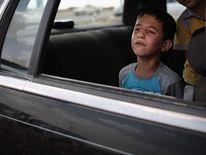 A refugee boy flees Iraq