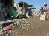 Residents inspect a blast site near a market in eastern Baghdad.
