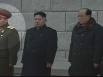 Ri Yong Ho and Kim Jong-Un