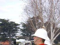 Two members of the Royal Marines Band Service play the Last Post at the funeral of former Royal Marine James McConnell