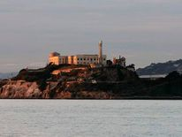 Island prison of Alcatraz is bathed in the light of setting sun in San Francisco Bay