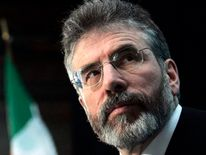 Sinn Fein leader Adams looks up during an extraordinary Sinn Fein meeting in Dublin