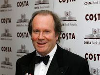 "Author Boyd poses with his book ""Restless"" at the Costa Book Awards in London"
