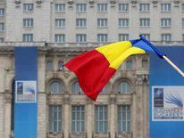 Romanian flag is seen in front of the Parliament Palace in Bucharest
