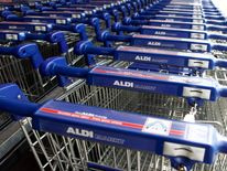 Shopping trolleys are pictured outside an Aldi supermarket in Berlin