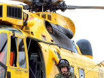 Prince William on board an RAF Sea King search and rescue helicopter