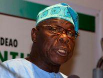 Former Nigerian President Obasanjo speaks at a news conference in Dakar