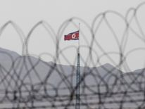 A North Korean flag flutters on top of a tower at the propaganda village of Gijungdong in North Korea taken from Panmunjom, north of Seoul