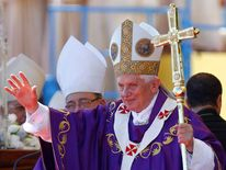 Pope Benedict XVI waves to the crowd after celebrating mass at Revolution Square in Havana