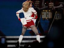Madonna performs on stage during her MDNA tour in St Petersburg