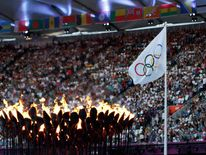 The Olympic Torch and flag
