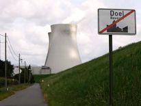 A city limits sign is seen near a cooling tower of the Doel nuclear plant near Antwerp