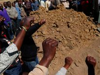 Miners salute the dead at the funeral of Andries Motlapula Ntsenyeho, one of 34 striking platinum mineworkers shot dead